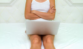 Woman's hands on notebook computer for relax. Royalty Free Stock Images