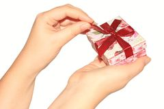 Woman's hands opening present box Royalty Free Stock Images