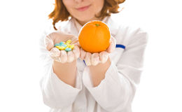 Woman's hands with orange and tablets Royalty Free Stock Photo