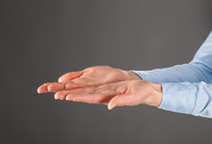 Woman's hands outstretched Stock Photos