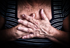 Woman's hands over her chest Royalty Free Stock Image