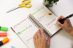 Woman`s hands with pen writing in planner. Modern office desk. W royalty free stock photo
