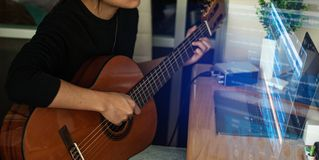 Woman`s hands playing acoustic guitar, close up royalty free stock image