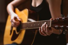 Woman's hands playing acoustic guitar, close up royalty free stock photos