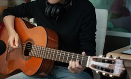 Woman`s hands playing acoustic guitar, close up.concept of recreation stock photos