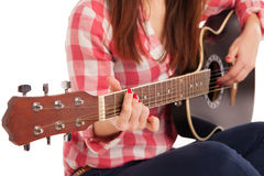 Woman's hands playing acoustic guitar, close up Royalty Free Stock Images