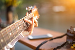 Woman's hands playing acoustic guitar, close up royalty free stock photography