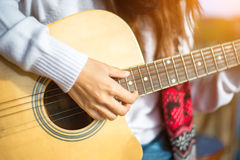 Woman`s hands playing acoustic guitar, close up Stock Photo