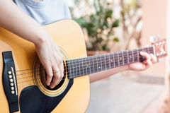 Woman's hands playing acoustic guitar Royalty Free Stock Photo