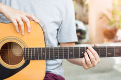 Woman's hands playing acoustic guitar Royalty Free Stock Photos