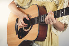 Woman's hands playing guitar, close up. Stock Photography