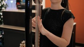 Woman`s Hands Playing Harp, Party And Celebration, Close Up Shot stock footage