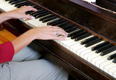 Woman's hands playing a piano Royalty Free Stock Photos
