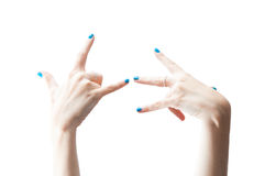 Womans hands postures. Womans hands with shinny blue nail polish isolated on  white Stock Photography