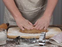 Woman's hands preparing dough for gingerbread cookie. Woman's hands in process of preparing of dough for gingerbread cookie. Toned royalty free stock photo
