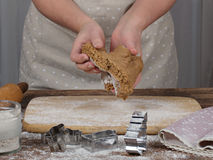 Woman's hands preparing dough for gingerbread cookie. Woman's hands in process of preparing of dough for gingerbread cookie. Toned royalty free stock photos