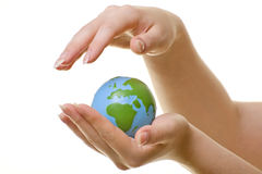 Woman's Hands Protecting Globe Stock Images