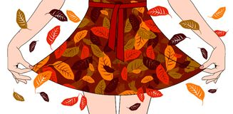 Woman`s hands pull the edge of the dress with autumn fall decora. Woman`s hands pull the edge of the dress with red and yellow leaves decoration. Fall Fashion Stock Photo