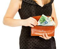 Woman's hands with purse and money Royalty Free Stock Image
