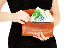 Woman`s hands with purse and money Royalty Free Stock Photos