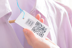 Woman`s hands with a qr code label Stock Photo