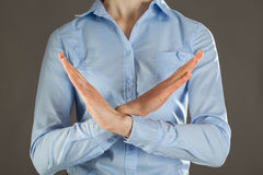 Woman's hands rejecting of something. Grey background Royalty Free Stock Photos