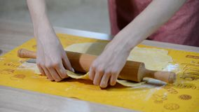 Woman`s hands roll the dough. Woman`s hands roll the dough stock video