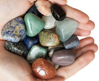 Woman`s hands with semiprecious stones. Stock Photos