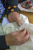 Woman`s hands sewing Stock Photography