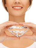 Woman's hands showing big diamond Royalty Free Stock Photography
