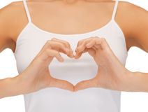 Woman's hands showing heart shape. Close-up of woman's hands showing heart shape royalty free stock photos