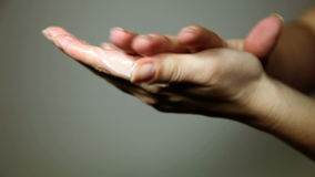 woman`s hands spreading a cream ower the fingers