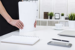 Woman`s hands with stack of papers Stock Images