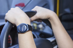 Woman's hands on the steering wheel of the car Royalty Free Stock Images