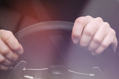 Woman's hands on steering wheel of a car Royalty Free Stock Photo