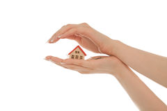 Woman's hands with toy house and keys. Isolated on white Stock Image