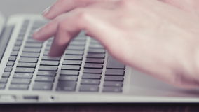Woman's hands typing on a laptop computer stock footage