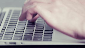 Woman's hands typing on a laptop computer. Woman's hands typing fast on a laptop computer stock footage