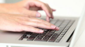 Woman�s hands typing on laptop keyboard stock footage