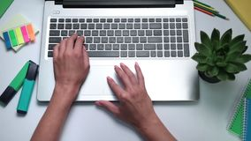 Woman's hands typing on laptop keyboard stock video