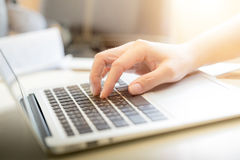 Woman's hands typing on laptop keyboard Royalty Free Stock Images