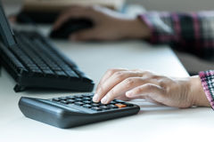 Woman`s hands using calculator on table Stock Photo