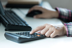 Woman`s hands using calculator on table Royalty Free Stock Photos