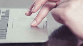 Woman's hands using a trackpad on a portable computer stock video footage