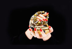 Woman's hands with various bracelets royalty free stock photo