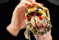 Woman's hands with various bracelets royalty free stock photography