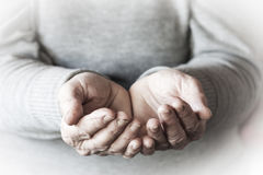 Woman`s hands waiting for alms Stock Photography