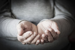 Woman`s hands waiting for alms Stock Image