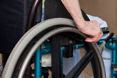 Woman's Hands on Wheelchair Royalty Free Stock Photo
