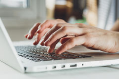 Woman's hands working on laptop computer Stock Photo